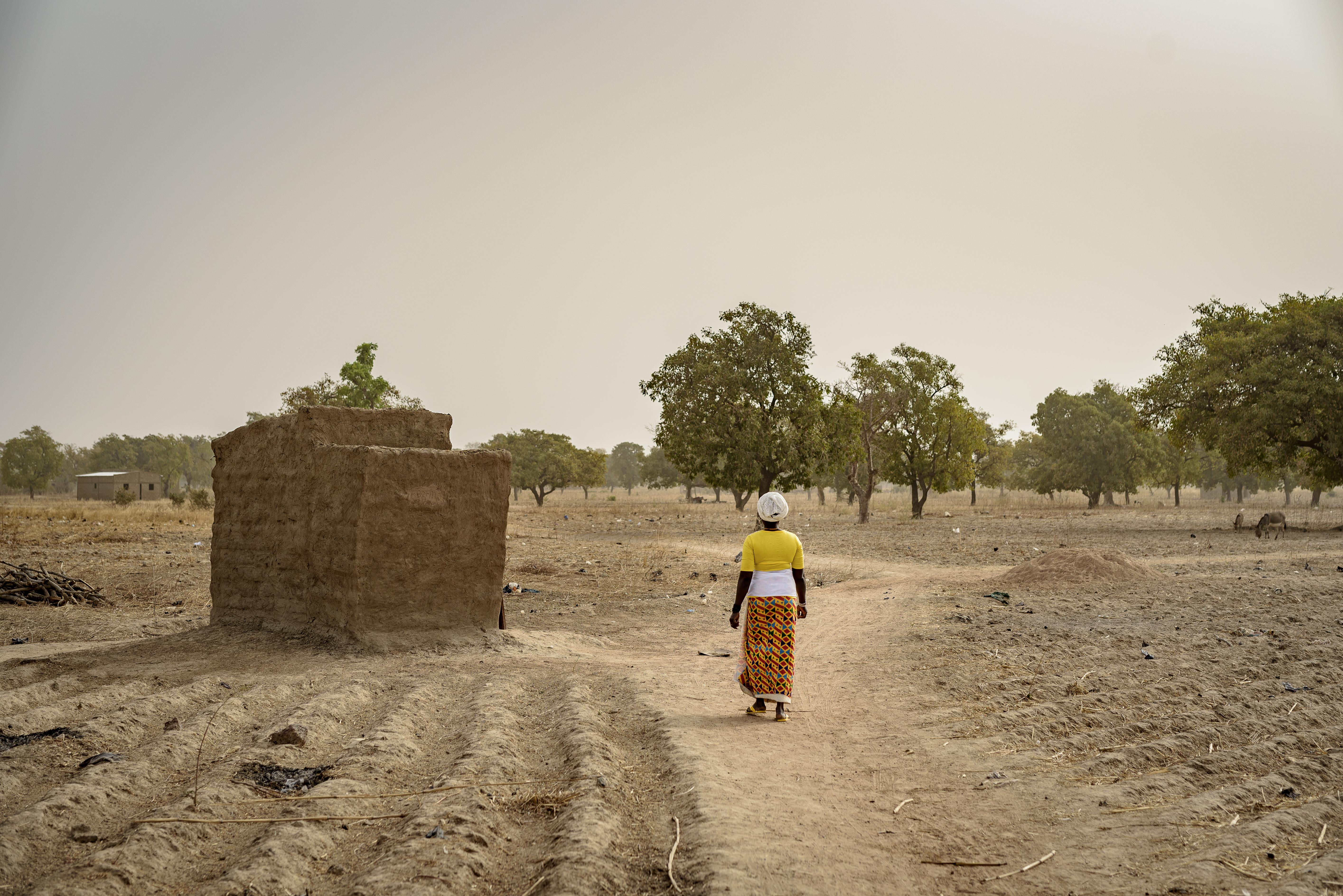 woman accessing a latrine