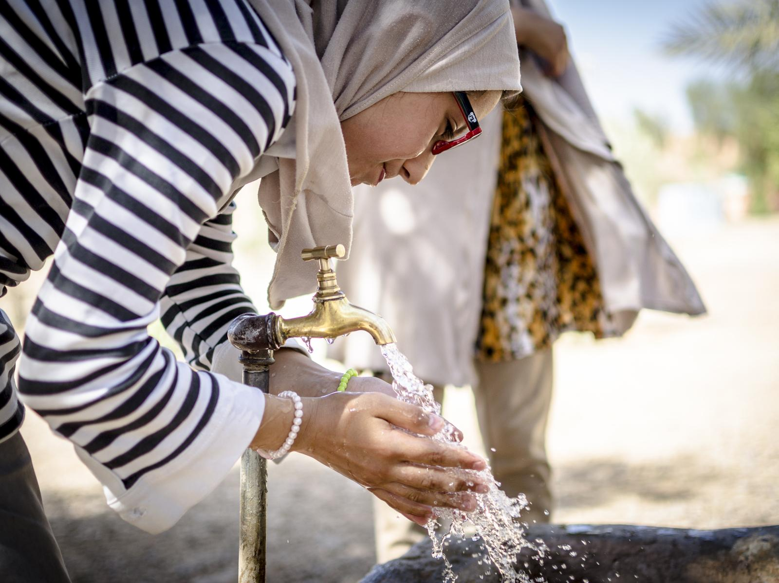 woman drinking water Morocco project