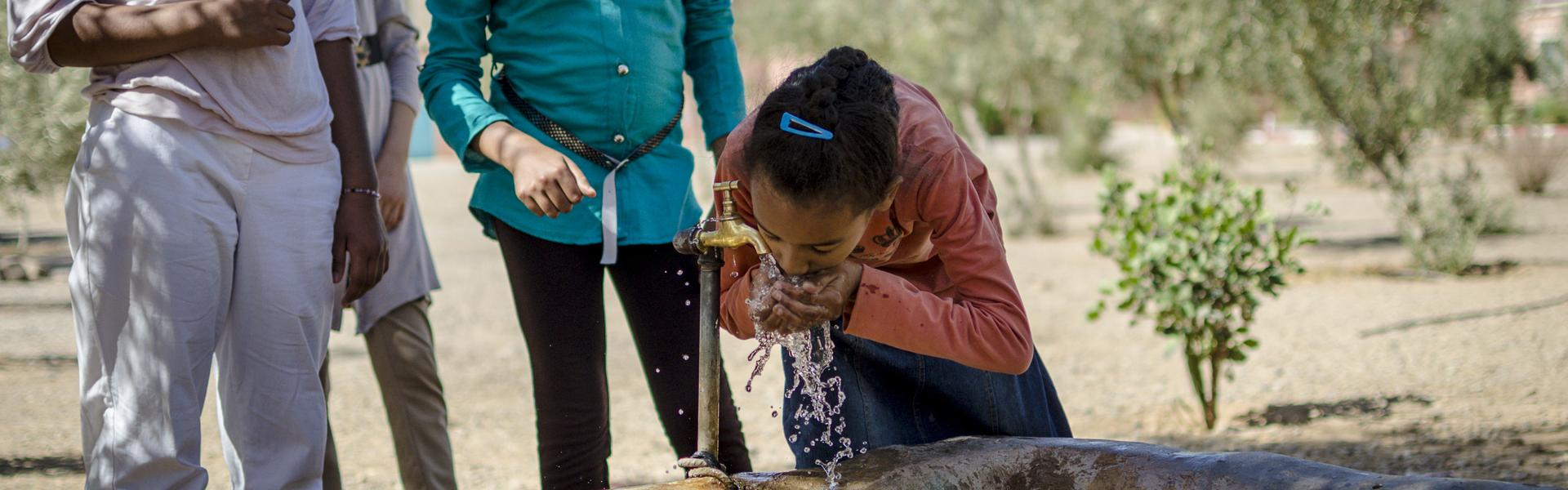 girl drinking water morocco