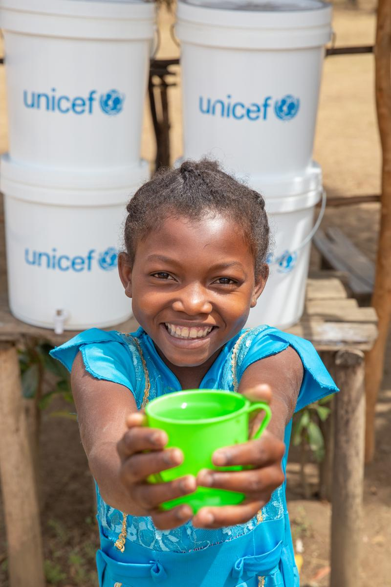 Girl with a cup of water madagascar project unicef