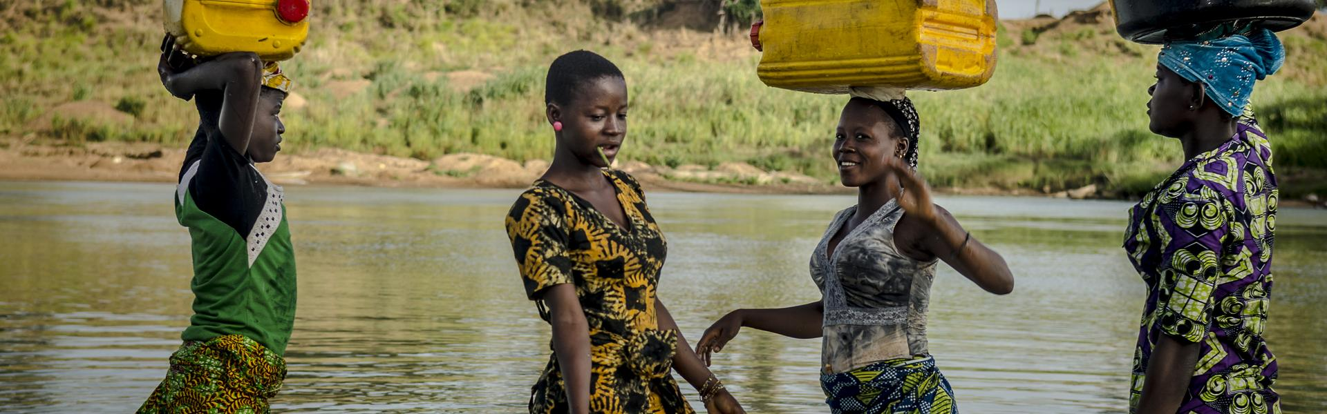 woman in the river fetching water