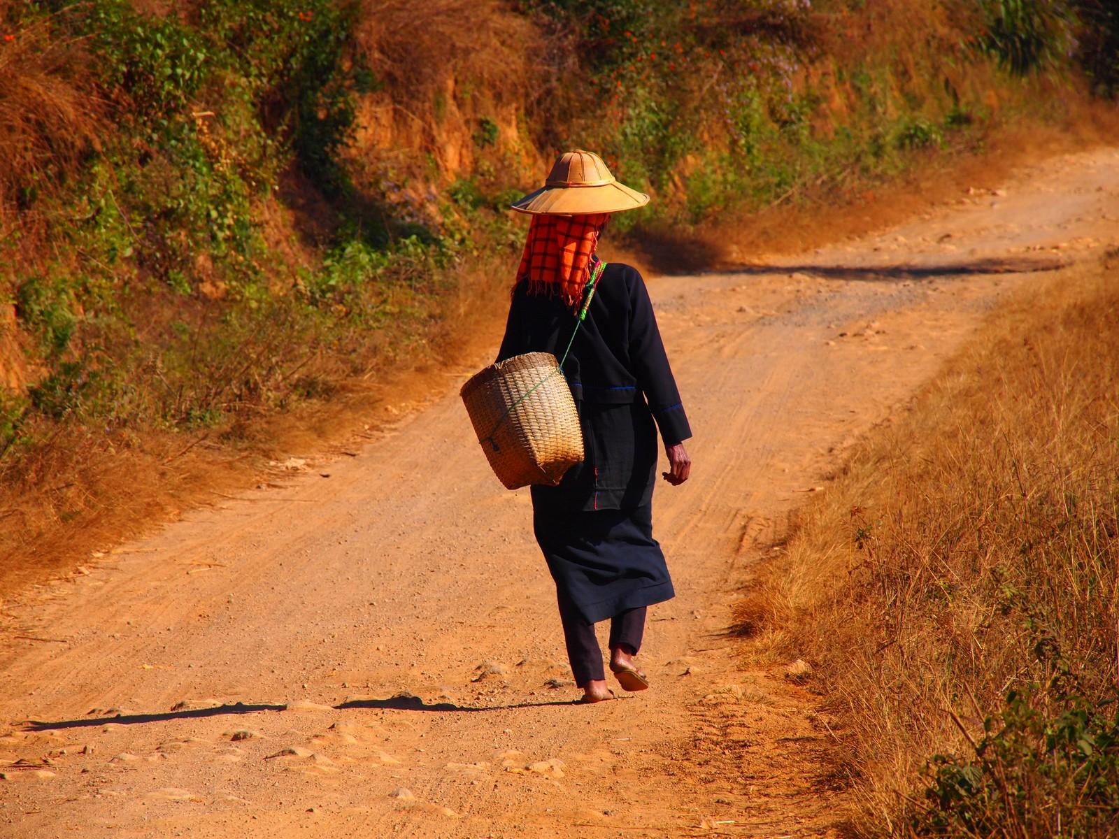 Burma's shan region woman walking